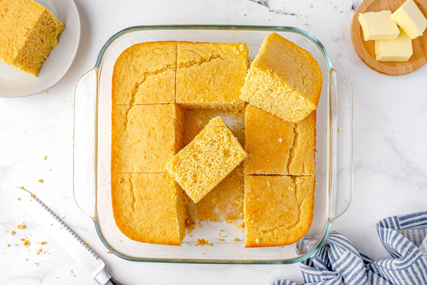 An overhead picture of cornbread cut up in the pan it has been baked in.