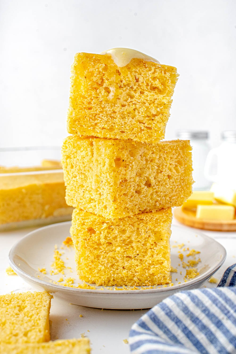 Three pieces of Sour Cream Cornbread stacked on top of each other.