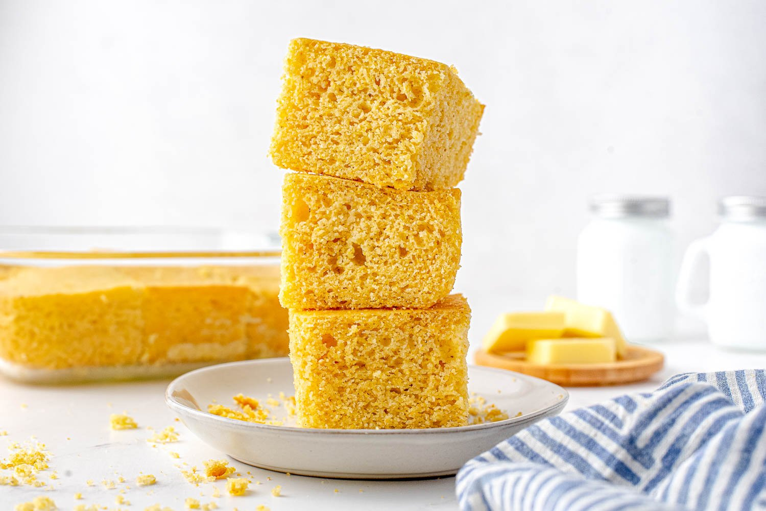 Three pieces of cornbread stacked on top of each other.