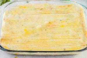 Use a fork to make ridges in the potato topping and brush topping with a beaten egg.