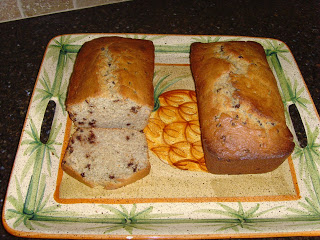 two loaves of America\'s Test Kitchen Banana Bread on a serving tray