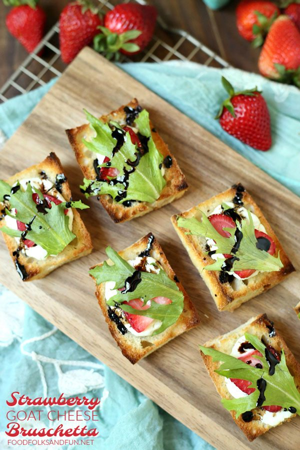 Strawberry Bruschetta on a wooden serving board.