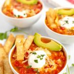 Tortilla soup in bowls ready to eat.