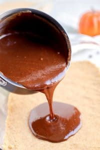 Pour the chocolate mixture over the graham cracker crust.
