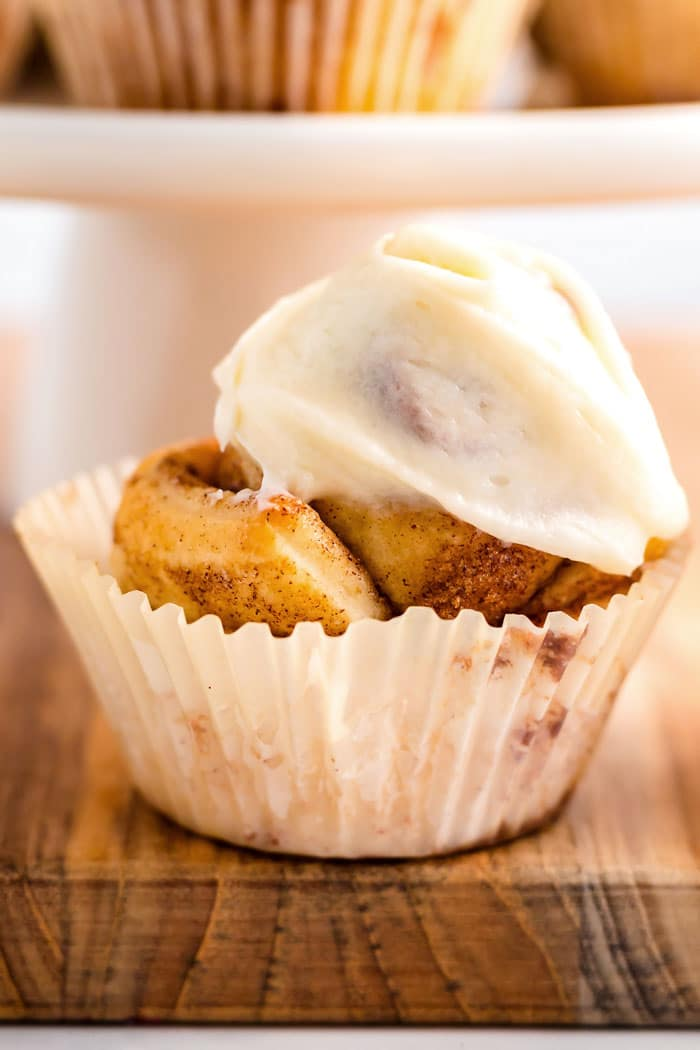 Cinnamon Roll Cupcake with icing on top.