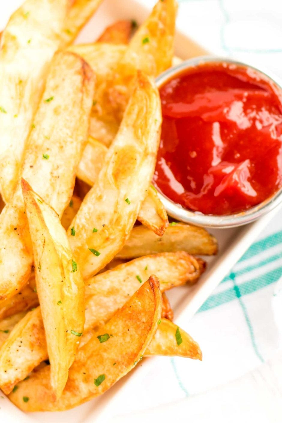 Overhead picture of Crispy Baked Oven Fries with a side of ketchup.