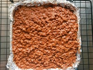 Pour the crunch mixture over the brownies.