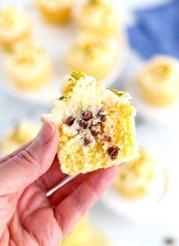 A half eaten cannoli cupcake.
