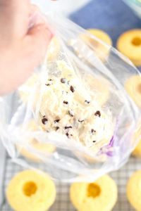 Add the cannoli filling to a piping bag.