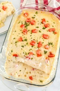 A pan full of creamy chicken enchiladas.