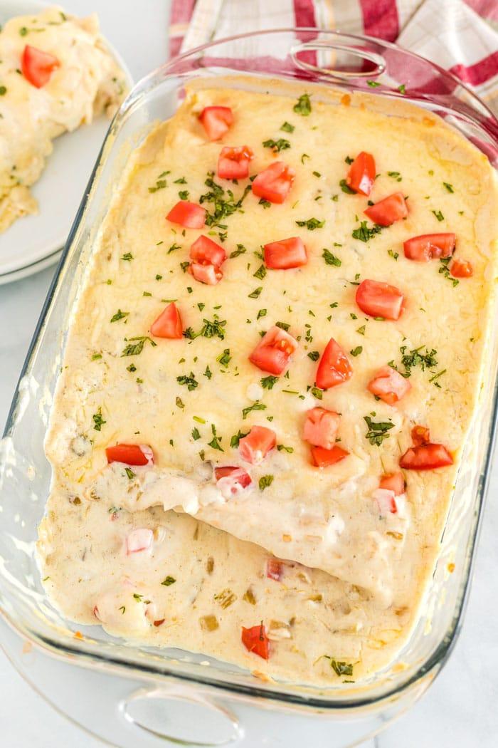 A pan full of creamy chicken enchiladas.