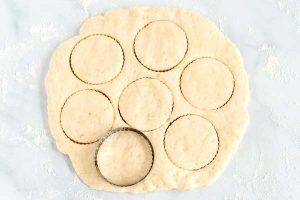 Use your fingers to pat out the dough and cut into rounds.