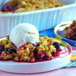 Mixed Berry Crisp on serving plates.