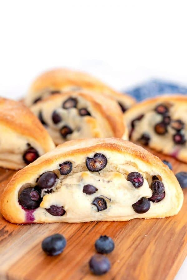 Blueberry scones on a wood cutting board.