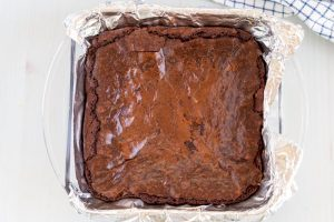 Bake the brownies as per the box instructions.