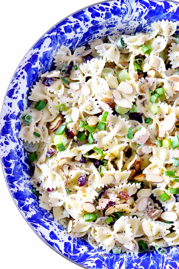 Chicken Poppy Seed Pasta Salad recipe loaded with chicken, grapes, Craisins, toasted almonds, and green onions.