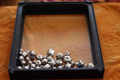 placing the jingle bells in the shadow box tutorial