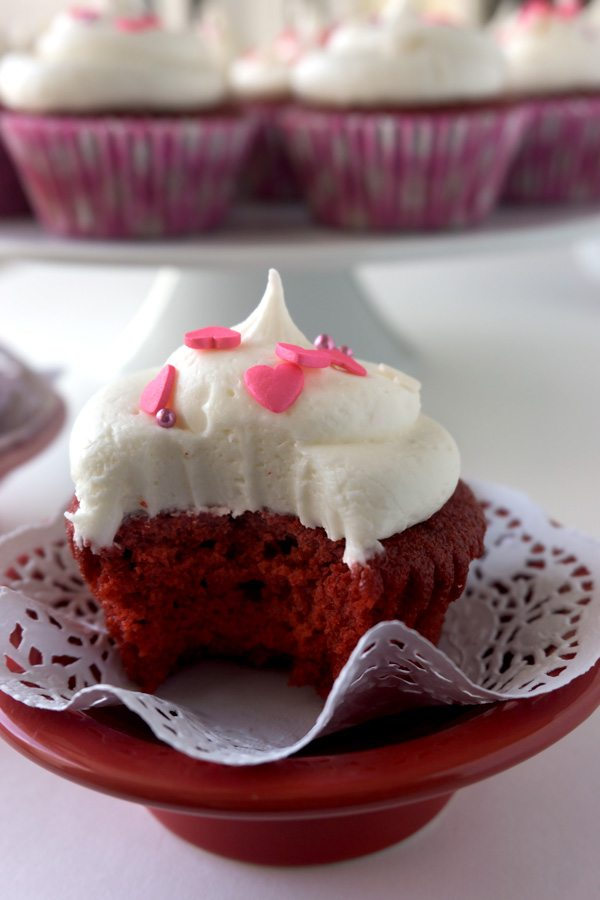 If you love Red Velvet Cake, then you'll LOVE these Red Velvet Cupcakes with Vanilla Cream Cheese Frosting! They're so moist and homemade!