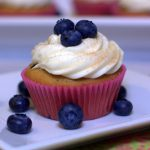a close-up of a Blueberry Pancake cupcake on a plate