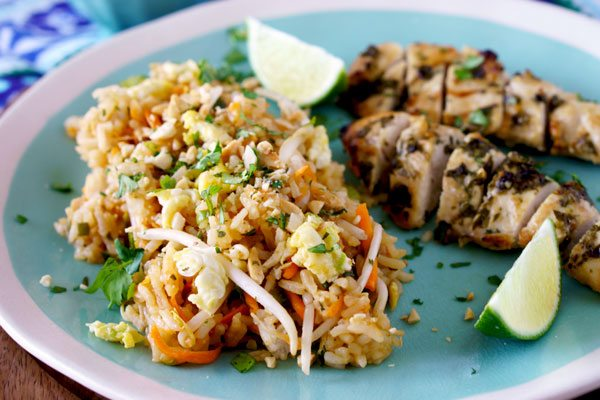 Thai Fried Rice with sprouts, lime juice, carrots, peanuts, and cilantro.