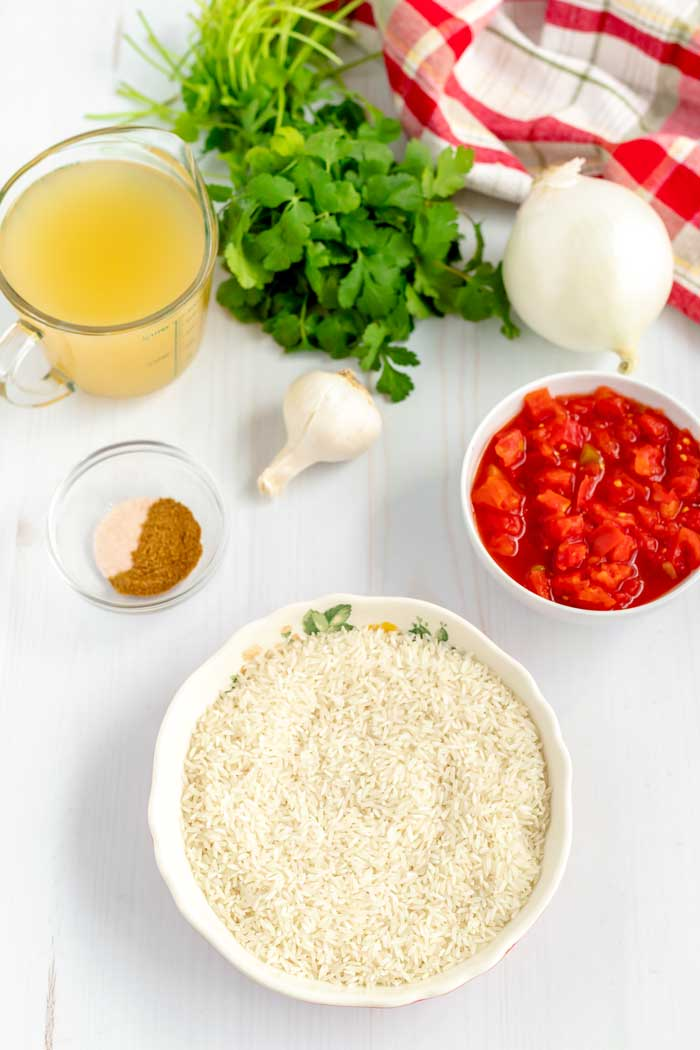 All of the ingredients needed to make homemade Mexican rice.