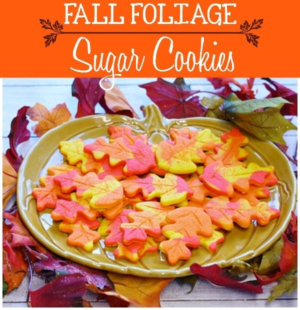 Fall Leaf sugar cookies on a pumpkin plate surrounded by real fall leaves.