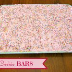 Cookie bars in a baking sheet with text overlay for Pinterest