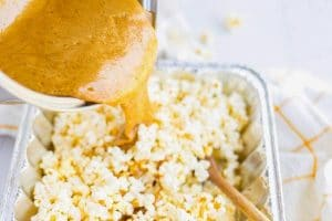 Pour the caramel over the popcorn and stir until the coated.