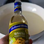White cooking Wine ingredient for making Spinach Artichoke Cheese Fondue