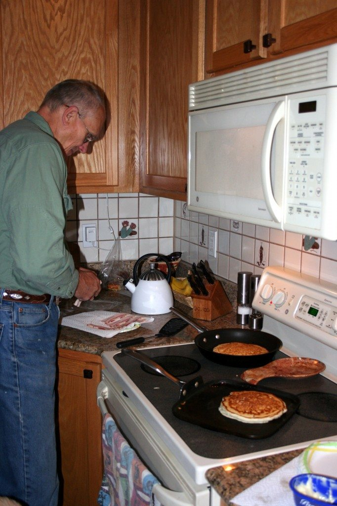 "My dad making his famous ""hotcakes""."