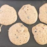 Blueberry Buckwheat Pancakes on a griddle