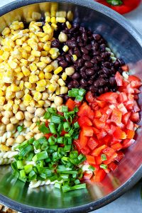 Add all of the veggies and beans to the pasta.