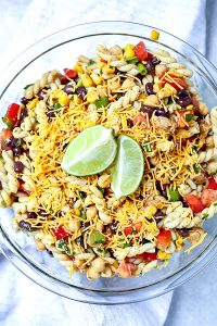 Overhead picture of southwest pasta salad in a glass serving bowl.