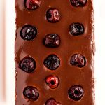 Spread ganache on top of cheesecake layer, dot with cherries, and chill for an hour.