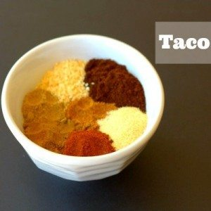spices needed for making homemade Taco Mix with text overlay for Pinterest