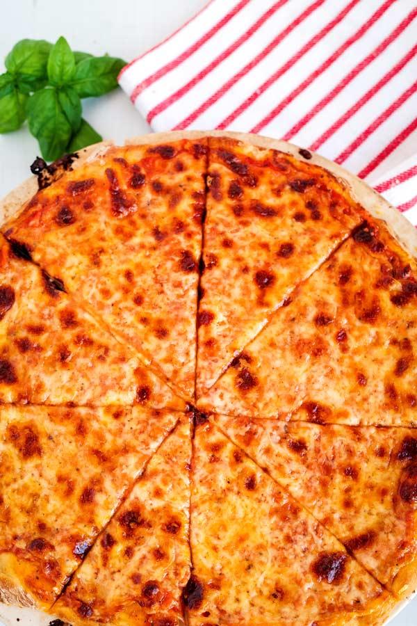 Finished pizza sliced for serving.