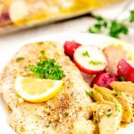 Baked Lemon Chicken on a plate with potatoes