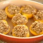 Baked Peaches with oat crumble in a baking dish