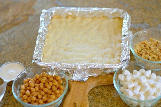 The shortbread layer with the topping ingredients.