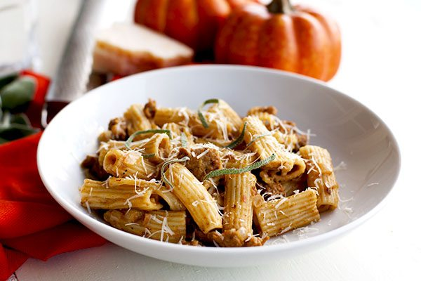 This Pumpkin Pasta with Sausage and Sage is the perfect comfort food dish for fall! It's creamy, spicy, and so flavorful. Plus it's on your table in just 25 minutes!