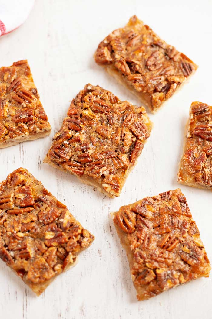 Pecan Pie Bars Squares on a white table top.