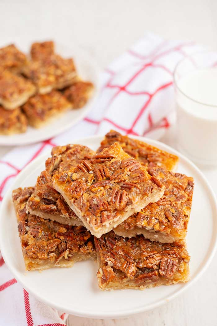 Pecan Pie Bars Thanksgiving Dessert on a white serving platter.