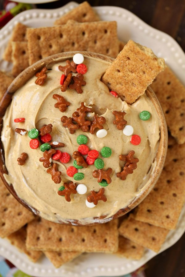 Overhead picture of cheesecake dip with a graham cracker dipped into it.