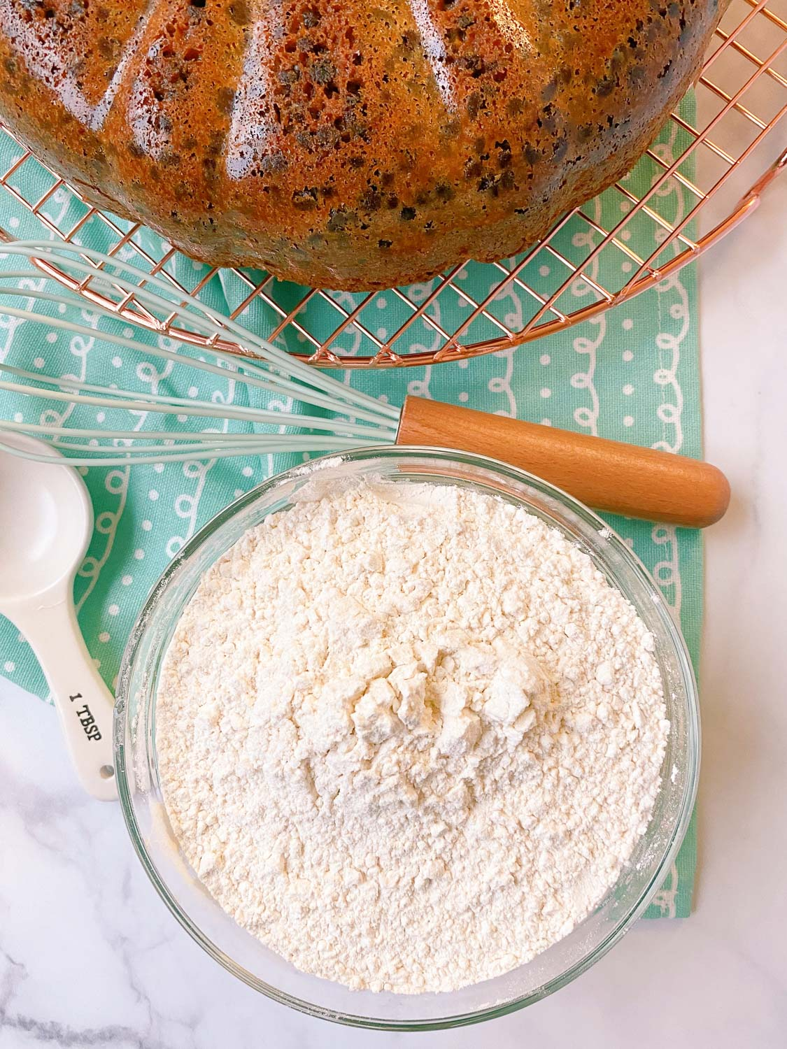 An overhead picture of the finished cake flour substitute with a cake in the background.