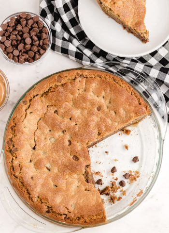An overhead picture of the finished Peanut Butter Cookie Pie with slices taken out of it.