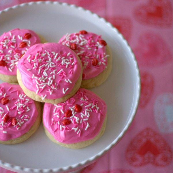 Soft, butter, addictive. That's how I would describe these Soft Frosted Sugar Cookies! This is a copycat for the Lofthouse sugar cookies and they actually taste better than the grocery store variety!