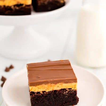 A brownie on a white plate.