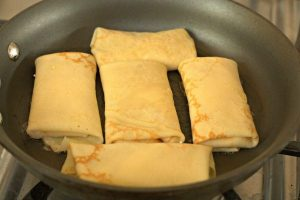 Strawberry and Cream Blintzes in a skillet