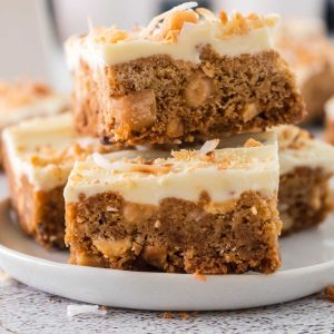 White Chocolate Blondies stacked on a white plate.