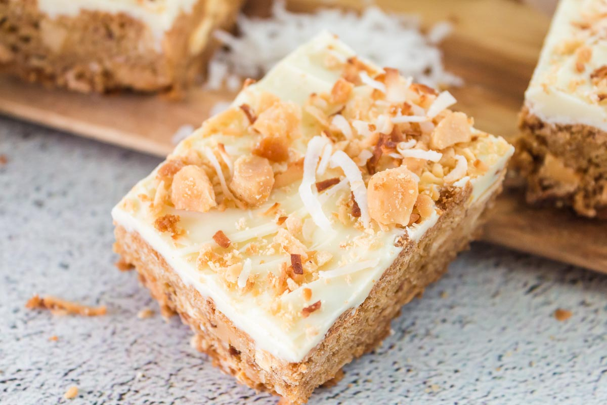 A close up picture of finished White Chocolate Chip Blondies on a platter.